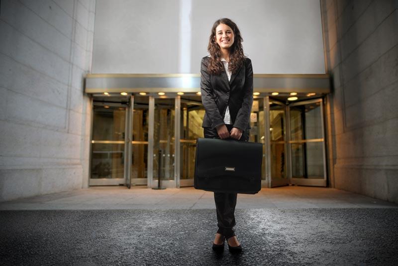 Lady holding suitcase